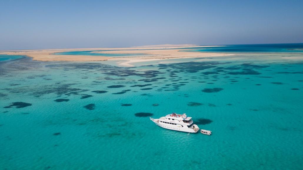 boat tawila trip Makani Beach Club Egypt Red Sea Cristal blue water reef corals island